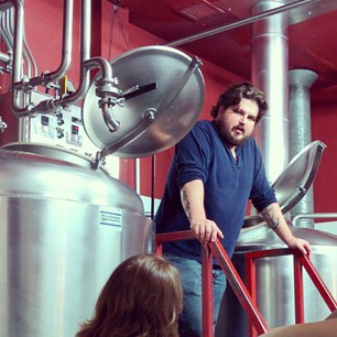 Marvin showing the fermentation tanks at Post Modern Brewery